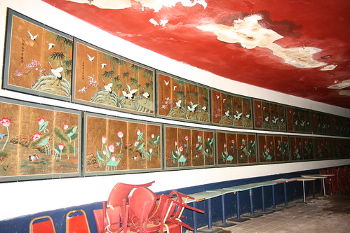 Repeating Asian themed wall hangings in the performance hall