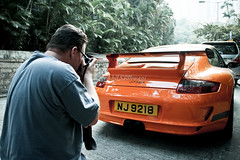 Porsche 911, GT3RS, Central, Hong Kong (Nikhil Sadhwani - Photography) Tags: china road morning orange money cars car metal speed canon photography hongkong eos drive amazing cool movement automobile shiny asia flickr doors ride photoshoot awesome flash wheels rich central machine fast voiture explore exotic transportation stunning driver motor hyper expensive streetcar quick limited luxury rare exclusive supercar automobiles spotting exotica horsepower porsche911 fastcars driven fastcar luxurycar motorcar accelerate 2011 acceleration gt3rs 600d hypercar worldcar motorizedvehicle highvalue nj9218