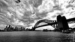 STORMY SYDNEY IN BLACK AND WHITE - NSW - AUSTRALIA (smortaus) Tags: city bridge blackandwhite bw cloud storm building water clouds cityscape gloomy edited sony sydney australian australia wideangle nsw harbourbridge northsydney sydneyharbourbridge blackandwhitephotography acity australianhistory blackwhitephotos sigma1020mmlens australianimage sonyalphaa350 australiancity dannyhayes sigmawideanglelense australianphoto landscapesofnsw nswaustraliansw sigmalense10mmto20mm snapshotsofaustraliainblackandwhite