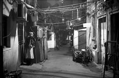 A cold night in Shanghai (Woods | Damien) Tags: china street blackandwhite film night alley shanghai noiretblanc rangefinder push   rue kodaktmax400 argentique olympus35sp
