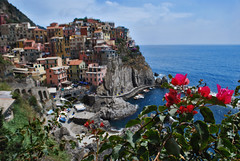Manarola in Cinque Terre (Jeka World Photography) Tags: world travel blue sea sky italy cliff cloud house mountain plant flower tree beach jeff nature water rose rock horizontal architecture river outdoors photography bay town nationalpark spring europe day cityscape village dusk liguria horizon nopeople unescoworldheritagesite unesco transportation coastline cinqueterre multicolored townscape manarola scenics liguriansea mediterraneansea clearsky frontview selectivefocus laspezia jeka traveldestinations colorimage jeffrose buildingexterior highangleview mediterraneanculture italianculture focusonbackground builtstructure nauticalvessel residentialstructure jekaworldphotography jeffrosephotography kalitharosephotography