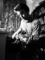 Recording (Mariekjen) Tags: boy playing boyfriend play guitar song olympus record olympuspen songs recording ep2 bwblackandwhite