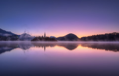 Purple Haze (TheFella) Tags: longexposure morning pink sun mist reflection slr castle church water yellow misty fog digital photoshop sunrise canon island eos dawn photo high europe purple dynamic foggy surface slovenia photograph processing slowshutter ljubljana bled 5d slovenija balkans dslr range hdr highdynamicrange balkan markii postprocessing mitteleuropa lakebled slovene bledcastle bledisland photomatix bledchurch republikaslovenija blejskojezero thefella 5dmarkii republicofslovenia conormacneill thefellaphotography northbalkans