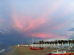 pinky (SS) Tags: city pink blue light red sea summer vacation sky italy brown white seascape storm black green beach water beautiful rain weather june clouds composition contrast umbrella landscape photography grey evening boat sand colorful soft paint barca mare waves mood dof view angle pov walk year perspective scenic favorites parasol framing lungomare bianco nero depth tone ambience comments baywatch foreshore abruzzo breakwater celeste roseto iphone costaadriatica atmophere lelitedespaysages
