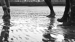 (SarahAHope) Tags: blackandwhite reflection beach wet water boot seaside sand shoes walk ripple trainers nike standrews stomp buckle shimmer