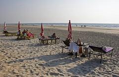 Life in the slow lane (bag_lady) Tags: ocean sea vacation india holiday tourism beach coast seaside sand goa tourists suntan sunbathing benaulim sunbeds lifeintheslowlane