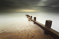 The Cloudy Beach (simon.anderson) Tags: sea beach water clouds coast moody timber rope textures le southcoast drama seaford cuckmere friston seafordhead simonanderson drmamtic hitechprostopper leehardndgrad09