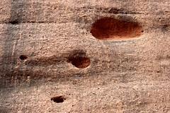 Three (wawrus) Tags: world red heritage pits rock site sandstone rocks desert nt centre details australia center holes unesco formation sacred uluru aboriginal northern ayers monolith territory pockmarks 447 inselberg ulara