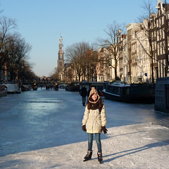 Samantha skating at the Westertoren (Bn) Tags: winter people cold holland ice hockey netherlands dutch amsterdam kids geotagged fun frozen chair downtown iceskating skating joy kinderen nederland freezing first canals age skate stick prinsengracht anton temperature stoel mokum occasion rare grachten pleasure skates blades winters stad harsh jordaan 2012 westertoren d66 ijs gluhwein schaatsen koud amsterdamse childern ijspret hendrick bruegel chocolademelk meester grachtengordel hollandse oudhollands pieck gekte winterse sferen avercamp geo:lat=52366802 ijzers ijsplezier jordanezen geo:lon=4882452 ijsnota