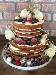 Naked wedding cake with fruit & flowers