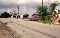 Houston, TX (otro_mun2) Tags: street light urban color clouds train factory texas crossing shadows decay telephone tracks houston beta pole harris coupe outlaw lancia contemporarylandscape
