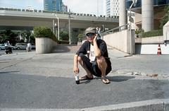 Squatting (Woods | Damien) Tags: china street man film phone shanghai telephone chinese streetphotography rangefinder   squatting olympus35sp  luckycharm200