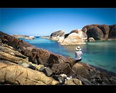Elephant Rocks... (Chantal Steyn) Tags: ocean longexposure blue sea woman seascape beach water rock lady landscape denmark coast nikon sitting looking tripod australia lagoon filter thinking slowshutter wa scape 16mm westernaustralia turqoise hoya elephantrocks d300 polariser nd400 nohdr silkywater williambay chantalsteyn