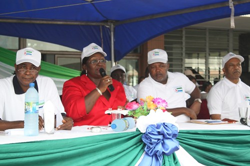 1st Lady Sia Nyama Koroma, addressing Rally. Flanked by Alpha Kanu - left and Hon Minister Alimamy Koroma - right