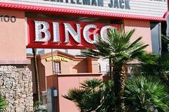 :Sin city lost & found: Bingo at the Terrible's in Las Vegas. (Gilbert Mercier) Tags: signs lasvegas nevada prostitution 35mmfilm americana bingo sincity terribles massageparlor weddingchapels nikkormatel photobygilbertmercier nikkorzoom43mmto86mm