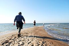 Fugitives. Rewa - 2008 (kuba paczkowski) Tags: sky people woman man color colour men beach water sand waves child streetphotography balticsea baltic walkers kuba paczkowski kubapaczkowski