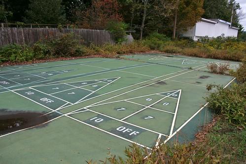 Cracking abandoned outdoor shuffleboard court