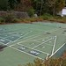 Cracking abandoned outdoor shuffleboard court