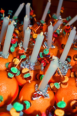 preparing for Christmas Eve (littlestschnauzer) Tags: christmas eve uk red orange west church st festival fruit candles symbol many yorkshire christian celebration sweets ribbon oranges sultanas michaels preparations emley 2011 christingles chrsitingle