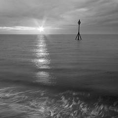 Last light at the Mile. (Happy New Year) Crosby (Ianmoran1970) Tags: light sea irish cloud sun reflection beach water liverpool river star surf wash flare mile mersey crosby ianmoran ianmoran1970