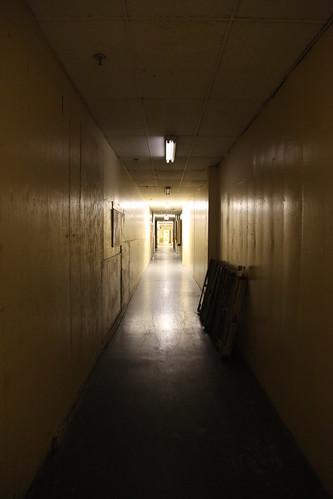 Long dark back corridor on first floor