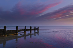 The Reds & Blues (Sunset Snapper) Tags: uk blue winter sunset red seascape beach beauty clouds reflections sand nikon january peaceful hampshire posts filters groyne d300 lowtide highlights haylingisland sunsetsnapper wetsand southcoast theredsblues seadefence ndgrads