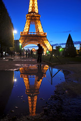 Reflections of Paris (Jeka World Photography) Tags: world city longexposure travel winter light sky people cloud motion paris france reflection tower jeff wet water rain weather rose vertical architecture night composition umbrella walking puddle outdoors photography europe solitude day loneliness metallic eiffeltower fulllength visit drop tourist romance illuminated lamps shallow meteorology electriclight jeka partof blurredmotion capitalcities traveldestinations colorimage famousplace jeffrose buildingexterior internationallandmark coldtemperature frenchculture builtstructure unknowngender jekaworldphotography jeffrosephotography kalitharosephotography