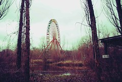 Forgotten Worlds (Sarah Porteus) Tags: world park city winter urban berlin abandoned overgrown clouds germany fun europe structures rusty fair eerie haunted creepy forgotten silence theme ghosts austere spreepark deccay planterwald