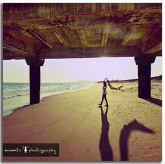 the girl with a dragon shadow... (PNike (Prashanth Naik)) Tags: light shadow sky woman sun india water lady pier sand nikon asia dragon sigma 1020mm pillars vizag vishakapatnam visakhapatnam d7000 pnike