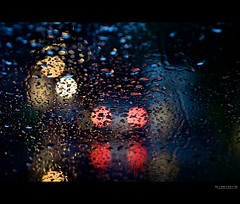 are we there yet? (elmofoto) Tags: california red white abstract water car rain weather northerncalifornia yellow 50mm lights evening bokeh fav20 raindrops intersection norcal fav30 1000v fav10 afsnikkor50mmf14g elmofoto btaws lorenzomontezemolo