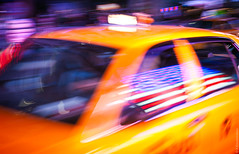NYC Taxi (thedot_ru) Tags: new york nyc newyorkcity newyork motion yellow geotagged flag cab taxi american canon5d 2012