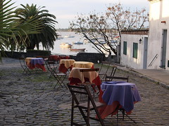 Cafe, Colonia del Sacramento (fame&obscurity) Tags: coloniadelsacramento colonia uruguay cafe cobbles tables boats calm tranquil empty lonely deserted emptyplanet rustic bohemian beatnik artsy pastels pastelcolours southamerica latinamerica summer summerevenings waterfront harbour trees palmtrees rest relaxed dinner solitude tablecloth pastel furniture tablesandchairs chairsandtables peaceandcalm boho