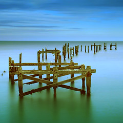Once a pier (Mark Leader) Tags: wood old uk blue sea sky colour green art beach water canon print eos coast pier soft long exposure mark picture silk calm structure shore dorset leader swanage newvision 40d panoramafotográfico theoriginalgoldseal peregrino27newvision