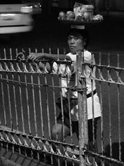 Balancing trick (ildefoto) Tags: poverty people blackandwhite bw art kids walking mono market photos philippines homeless smiles streetphotography places things cebu filipino tradition pinoy visayas filipinos streetphotos pinoys poorpeople bisaya cebuano bisdak blaclandwhite