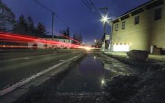 Light Trails No. 2, 2014.04.02 (Aaron Glenn Campbell) Tags: longexposure snow rural sunrise reflections wednesday spring highway traffic pennsylvania country 2nd powerlines slowshutter april lehman lighttrails telephonepoles puddles nepa 2014 luzernecounty backmountain sigma1020mmf456dchsm route118 cooksstore