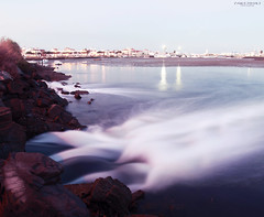Speed water (Pablo  Ronald) Tags: blue houses light espaa seascape luz water azul night landscape noche spain agua scenery rocks exposure nightshot huelva paisaje scene arena reflect reflejo casas seda exposicion piedras orilla ayamonte espuma waterscape puntadelmoral pabloronald