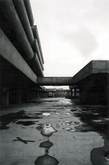 (The New Motive Power) Tags: city shadow urban abandoned monument k shop architecture modern contrast analog shopping concrete grey design closed moody quiet cloudy foreboding empty centre grain hard lofi modernism dramatic overcast icon structure urbanexploration silence massive portsmouth disused rough stark carpark lowkey iconic derelict complex deserted imposing brutalism modernist brutalist brutal ue urbex tricorn subdued owenluder btonbrut rodneygordon