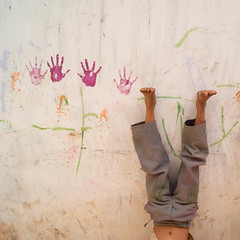 Four hands and two feet (Kokkai Ng) Tags: street india wall square fun asia paint child upsidedown agra dirty celebration vandalism holi handprint messingabout littleboys uttarpradesh humanhand humanfoot littleboysonly lpplay