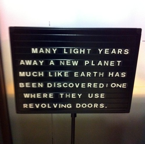 Many light years away a new planet much like each has been discovered; one where they use revolving doors.