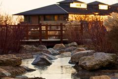 Icy Deneb (giantmike) Tags: bridge winter sunset building ice water creek evening rocks verona wi canonef100mmf28lmacroisusm