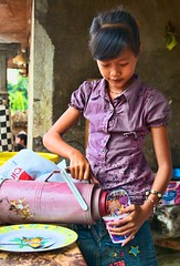 A young girl in Singaraja, Bali makes herself some noodles. (mikaku) Tags: ocean travel sunset portrait bali girl indonesia photo pretty tour young lovina 2011 singaraja balian