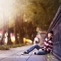 (brandonhuang) Tags: road street light boy portrait blur color colors self canon fence person warm sitting dof bokeh walk side taiwan sidewalk sit taipei f2 135 135mm f2l brandonhuang