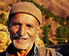 Cemoy Yasn,( a mountain face) (NESIHO) Tags: trip light sun man mountains cold adam smile face smiling evening pain shine uncle hard photojournalism september orphan sparkle tough grief homeland lans photojournalist kurdish kurd sunnydays yuz hardlife cemil cemo panoramafotogrfico nesiho