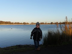 paul by the lake (And Soon the Darkness) Tags: blue boy sky lake nature water paul reserve peterborough eyegreen
