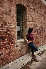 (Taylor F.) Tags: black brick window girl wall purple boots cement piercing jeans brickwall bellybutton croptop