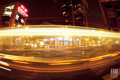 Go By Streetcar Part III (Ian Sane) Tags: street light 3 car by night oregon train portland lens ian lights three long exposure downtown streak head district iii go tracks images fisheye part transit pearl 11th mass streetcar avenue trimet lovejoy sane