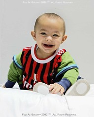 SMILIMG.. (Late) Happy New Year :) (FoZiGraPhy) Tags: baby milan cute photographer sony alfa ac fawzi fozi          albalawi albuluwi