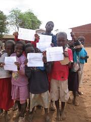 report cards (Vincentello) Tags: school boy girl children report card malawi enfants fille bulletin école garçon scolaire njewa