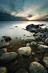 Rocks & Water - Bomstad (- David Olsson -) Tags: longexposure sunset lake cold water clouds landscape nikon rocks sweden stones january sigma pebbles karlstad le 1020mm polarizer 1020 vnern cpl 2012 vrmland polarizingfilter ndfilter lakescape smoothwater d5000 bomstad davidolsson nd500 lightcraftworkshop bomstadbadet 2exposuremanualblend ginordicjan ginordicjan12 bomstadcamping
