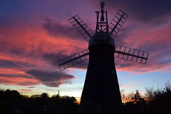 Holgate Windmill on Christmas Day (nican45) Tags: wood york sunset sky orange cloud colour mill windmill silhouette clouds purple yorkshire cap sail restoration holgate ogee fantail hwps holgatewindmill